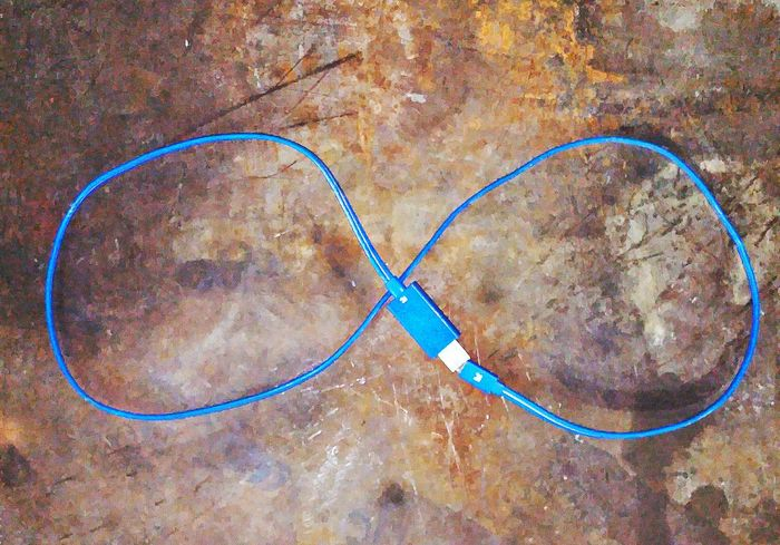 The OO Mission Phone Charger Cable Phone Cable Blue Cable Blue Color Double Helix Infinity Forever Rusty Rusty Background Iron Old Table Textures And Surfaces Rough Surface Steel Table Phone Accessory Cell Phone Charger Technology Shapes And Patterns  Shapes And Textures Equipment Cell Check This Out