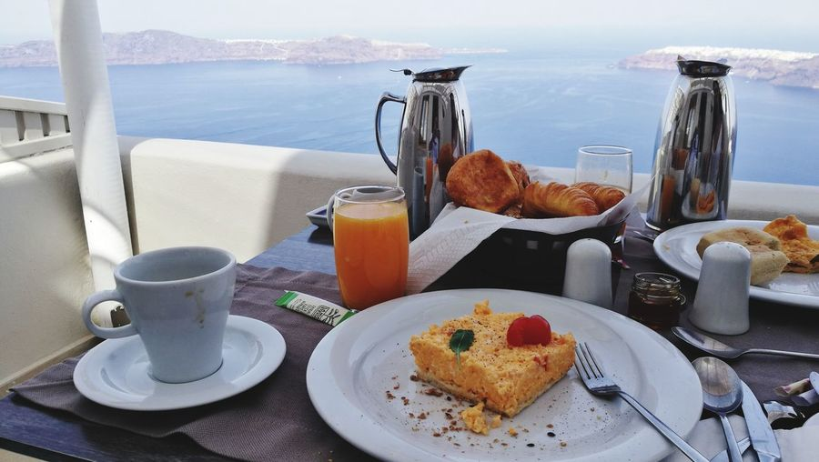 Close-Up Of Breakfast On Table By Sea At Restaurant