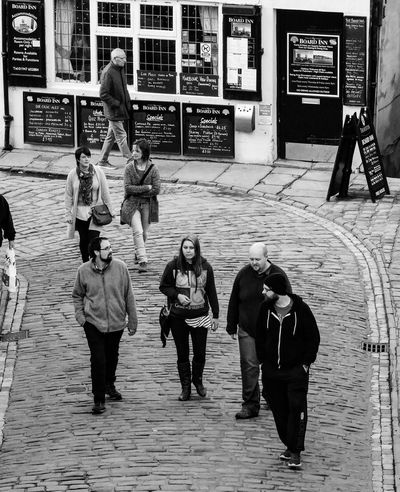 Street Photograhpy Streetlife Monochrome Photography Black And White People Walking Lifestyles Outdoors Cobbled Street Public House Pub Bar