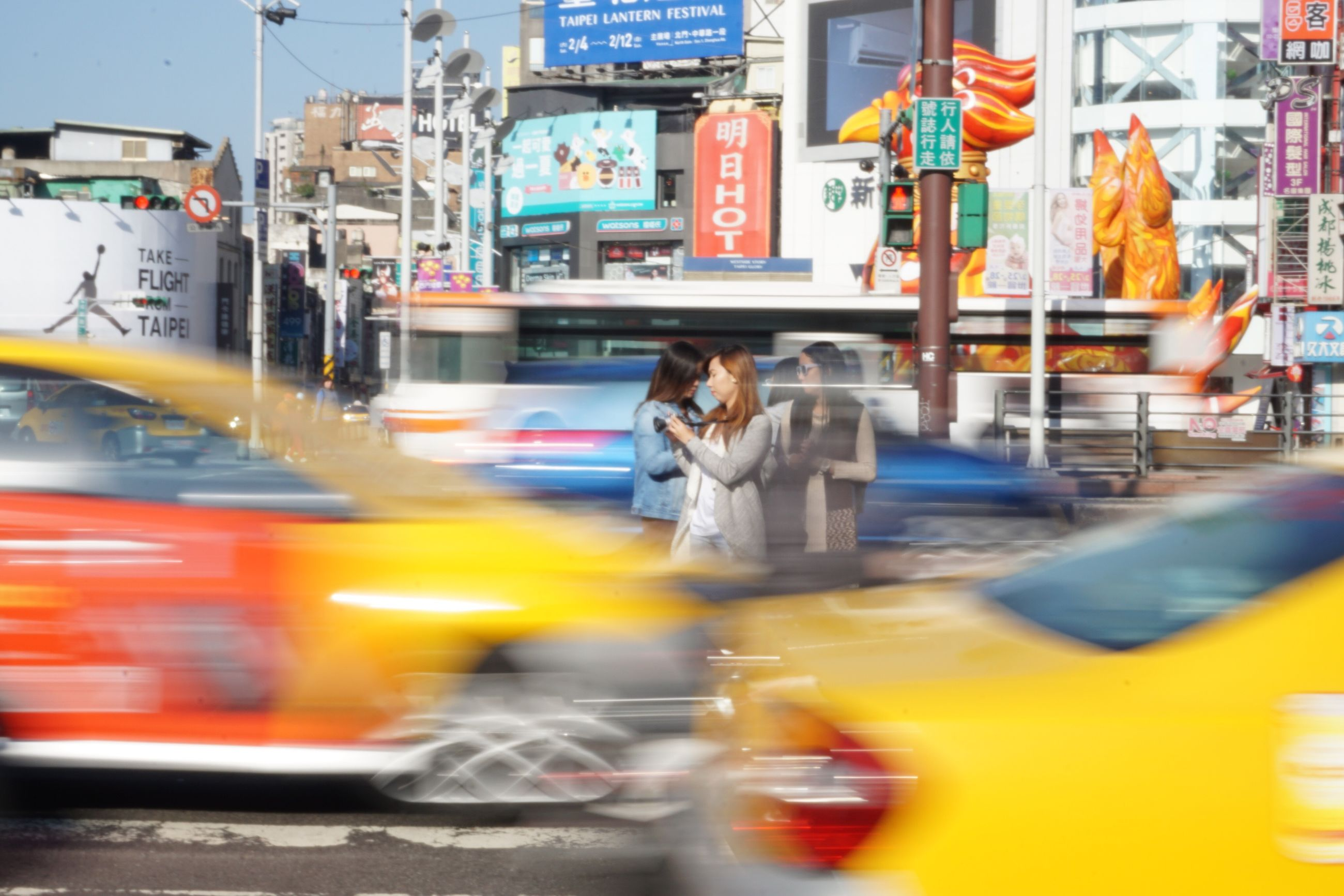 city, blurred motion, speed, car, city life, full length, public transportation, people, outdoors, young adult, adults only, day, adult