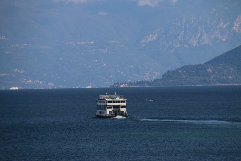 The KIOMI Collection Lago Di Garda Mountains Lake Lake View Boat Blue Sky Blue Water Sun Lovely Vieuw Lago Taking Photos Enjoying Life Photography No Filter Love Making Pictures Italy Italyiloveyou Nice