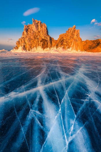 Scenic view of frozen lake against rock formation
