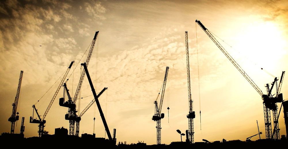 Constructions work - Tower cranes Background Wallpaper Tower Cranes Civil Civil Engineering Engineeringstructures Engineering Sky Yellow Silhouette Warm Black Shadow Clouds City Urban Real Estate Buy Build Building High Tall Sell Project Bird Sunset Silhouette Arts Culture And Entertainment Sky Cloud - Sky