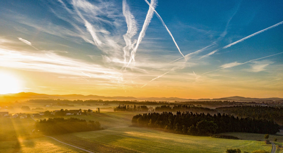 Panoramic view of bavarian landscape against sky during sunrise