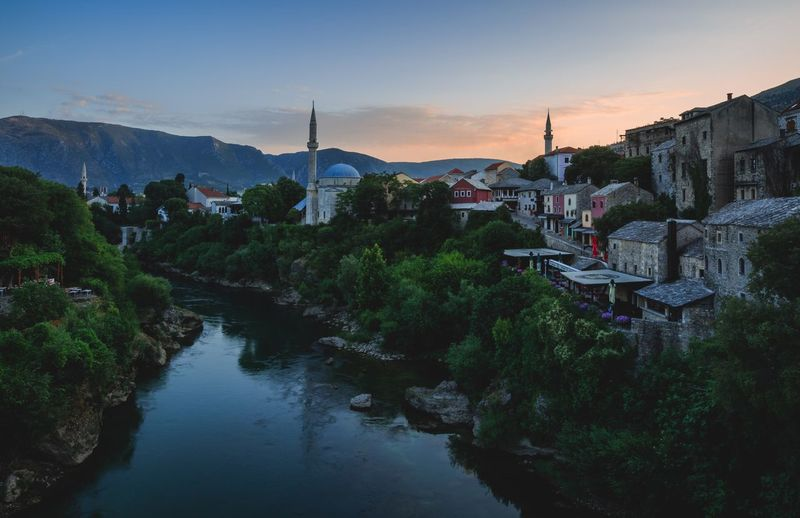 Old town Mostar Mosque Sunrise Architecture Built Structure Building Exterior Sunset Sky Outdoors Mountain Travel Destinations No People Nature Water Tree Mountain Range Scenics