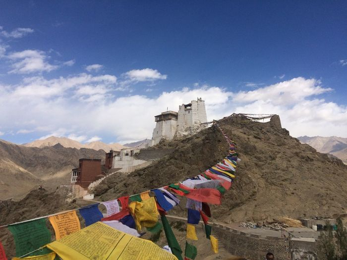 Colorful prayer flags on himalayas against sky