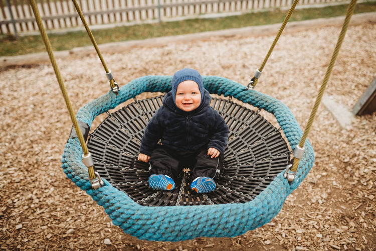 Portrait of happy boy in playground