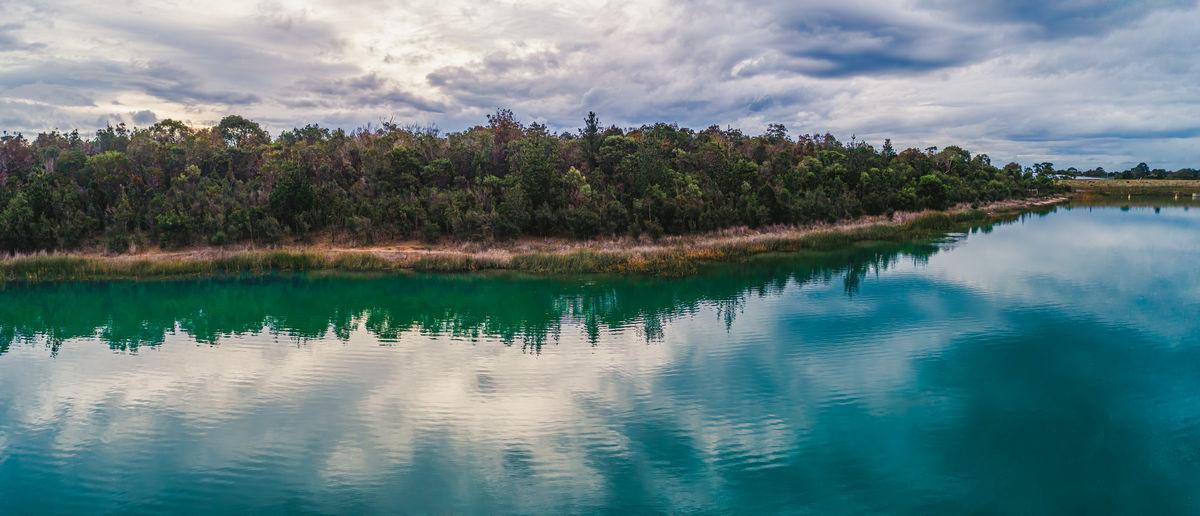 Panoramic view of native australian vegetation reflecting in the lake water