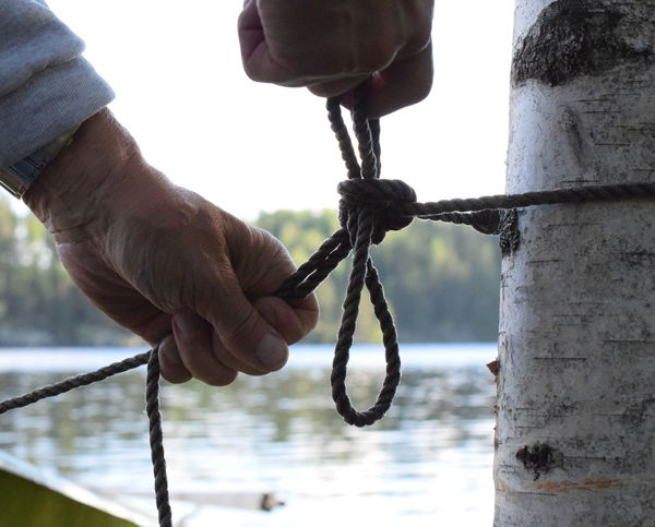 Knotted rope. Bearch Body Part Chain Close-up Connection Day Finger Fixing The Boat Focus On Foreground Hand Holding Human Body Part Human Hand Knot Knotted Rope Men Metal One Person Outdoors Real People Rope Strength Tied Knot Tied Up The Great Outdoors - 2018 EyeEm Awards