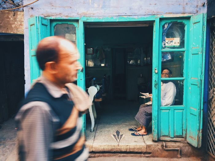 Turquoise barber shop catching my eyes IPhoneography Iphoneonly EyeEmBestPics Iphonesia Iphonephotography EyeEm VSCO EyeEm Gallery Men Real People Adult Lifestyles Males  Casual Clothing The Street Photographer - 2018 EyeEm Awards Architecture Communication Standing