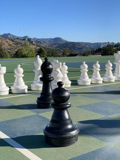 Full frame shot of chess board against mountain range