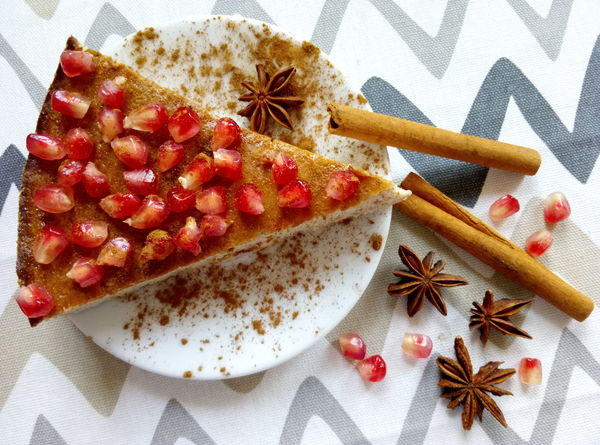 Homemade cheesecake with pomegranate seeds and cinnamon sticks and star anise Fruit Plate Star Anise Food Sweet Food Ready-to-eat Spice Decoration Dessert Pomegranate Seed Pomegranate Anise Cinnamon Sticks Tasty Christmas Decoration Close-up Scented Celebration Cake Food And Drink Cheescake Red Cinnamon Pattern Decor