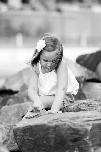 The Portraitist - 2017 EyeEm Awards Cute Leisure Activity Playing Outdoors Girl Girls Blackandwhite Black And White Black And White Photography Monochromatic Looking Down Rules The Street Photographer - 2017 EyeEm Awards Relaxing Sweet Exceptional Photographs White Love Drawing