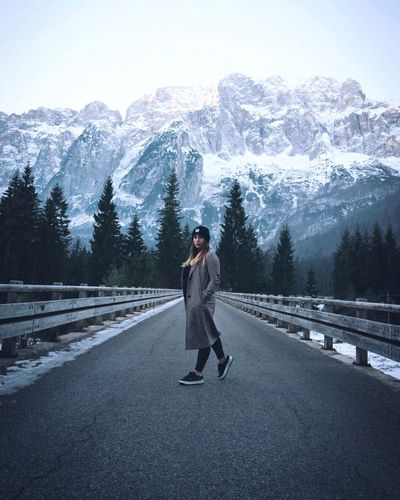Val Saisera ,Italy 🇮🇹 Real People Winter Full Length Lifestyles Cold Temperature Leisure Activity Young Women Nature Standing Non-urban Scene Scenics - Nature Tree Mountain Warm Clothing Young Adult Snow Beauty In Nature Front View Sky