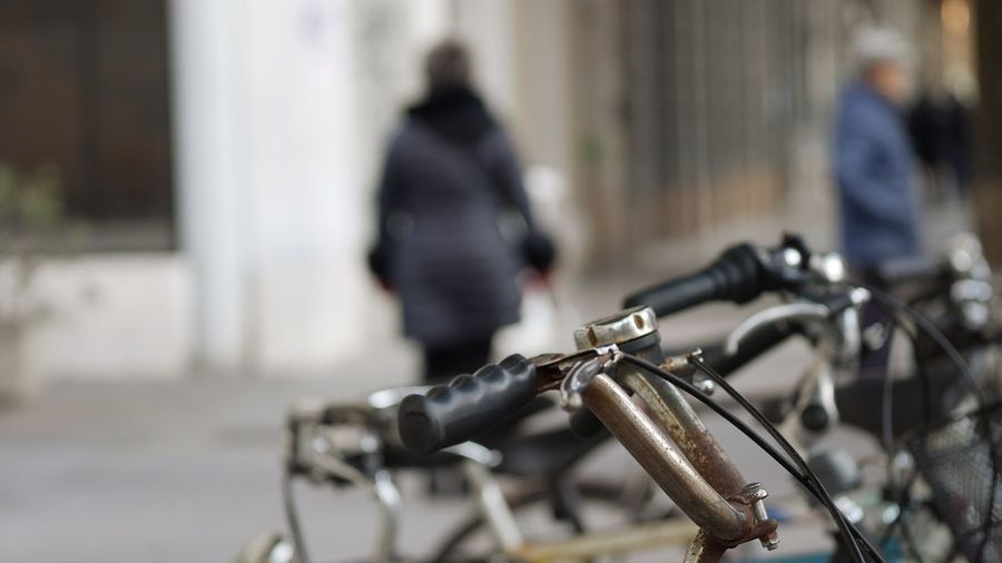 EyeEm Selects Bicycle Incidental People Focus On Foreground Mode Of Transportation Transportation City Land Vehicle Day Architecture Street Built Structure Outdoors Stationary Building Exterior Selective Focus Metal People Nature