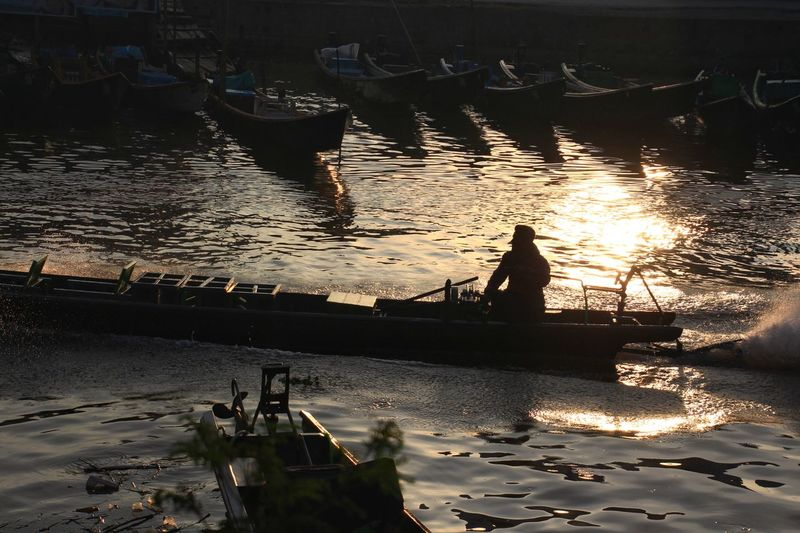 At Nyaungshwe, Myanmar Port Pier People One Person Rear View Working Real People Nature Lifestyles Outdoors Countryside Rural Calm Horizontal Asian  Boats Inlelake Myanmar Float Dramatic Sillouette Shadows & Lights Water Sunset Sea Silhouette Agriculture Sky