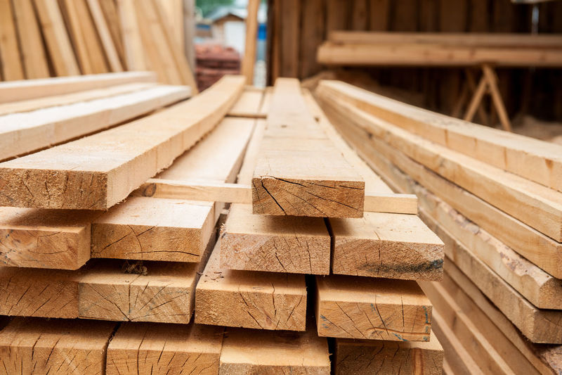 Stack of wood at construction site