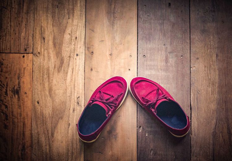 Red shoes on wooden floor Directly Above Brown Shoelace Day Hardwood Floor Absence Personal Accessory High Angle View No People Close-up Wood Sports Shoe Compatibility Still Life Flooring Indoors  Two Objects Wood - Material Pair Shoe Vignette Fashion Wood Grain Pink Color Indoors