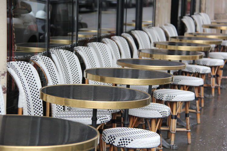 Empty Chairs And Tables Arranging At Cafe