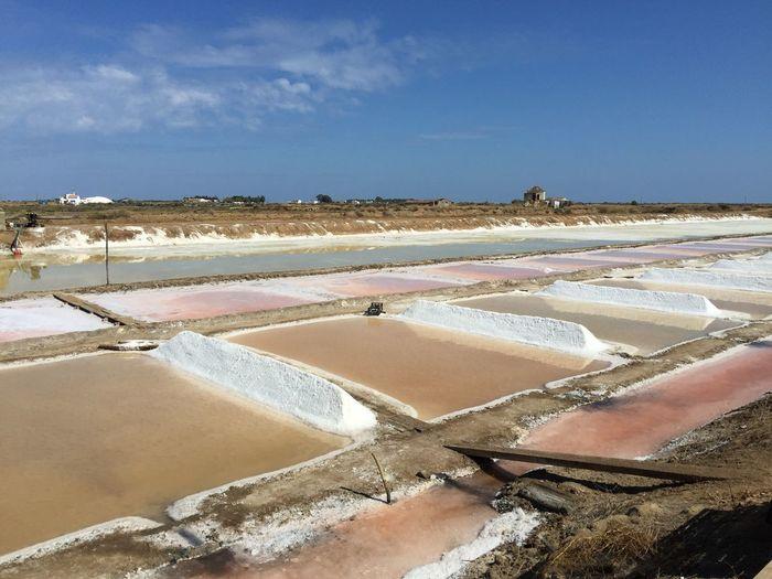Salt basin against sky