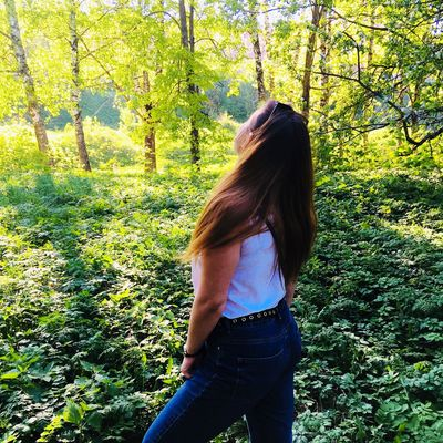 One Person Real People Lifestyles Plant Three Quarter Length Long Hair Hairstyle Nature Land Day Green Color Women Hair Leisure Activity Casual Clothing Young Women Grass Teenager Growth Outdoors
