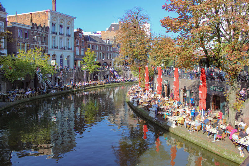 Sunny afternoon in Utrecht Reflection Water Large Group Of People Outdoors Architecture Tree Nautical Vessel Building Exterior Day Sky City People Fun Restaurant City Travel Destinations Built Structure Architecture Tree Scenics Clear Sky Blue Cityscape Classic Street Afternoon