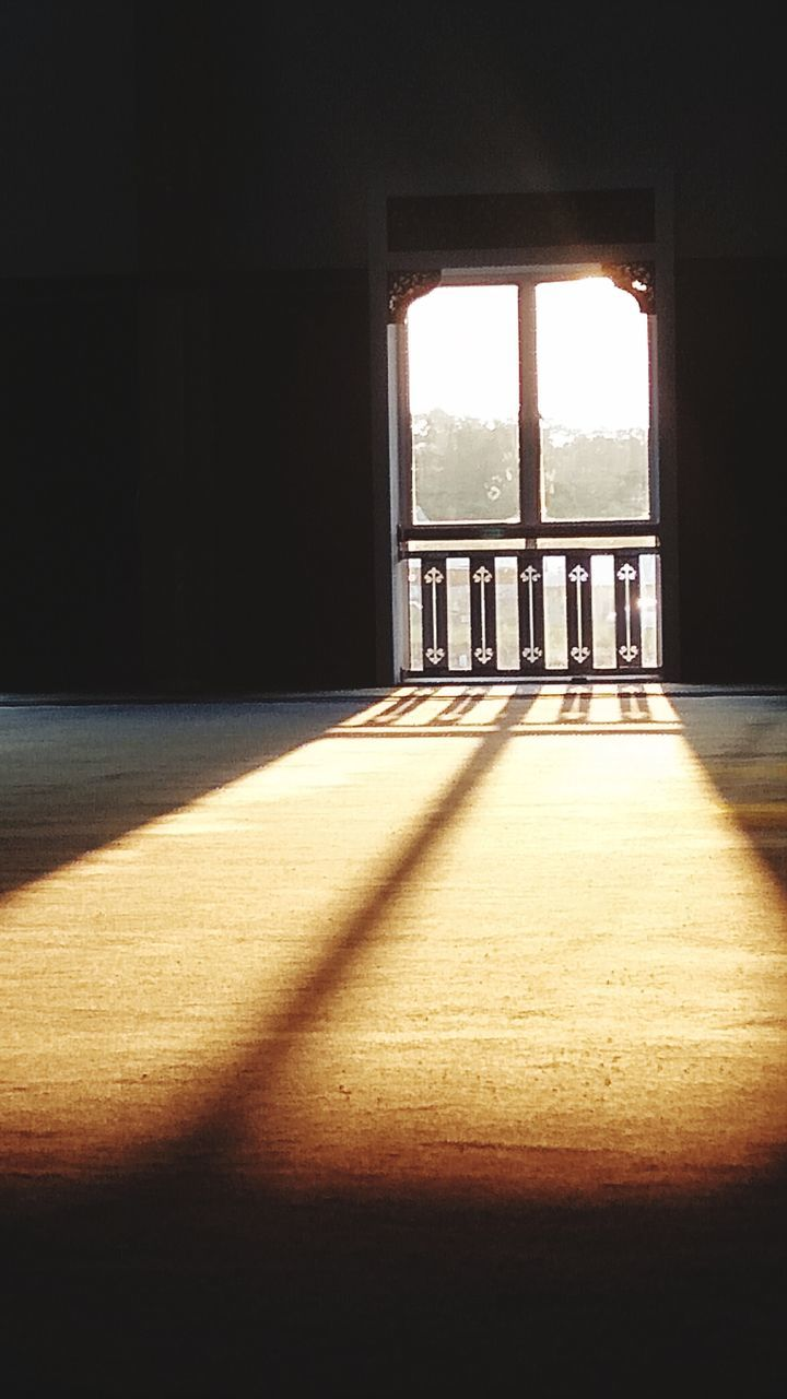 sunlight, shadow, indoors, architecture, day, window, no people, nature, flooring, built structure, building, falling, empty, entrance, domestic room, door, glass - material, absence, window frame
