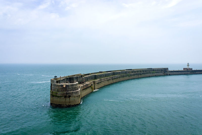 Dover pier amidst sea against sky