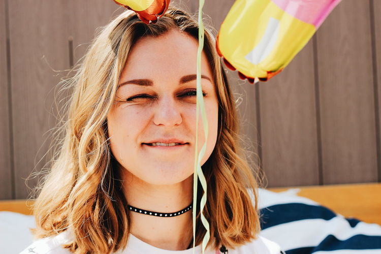 Close-Up Of Young Woman With Balloons