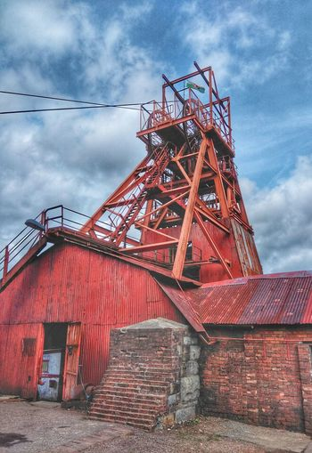 steel wheels Coal Mine Shaft Coal Mining Technology Red Sky Architecture Built Structure Cloud - Sky Overcast
