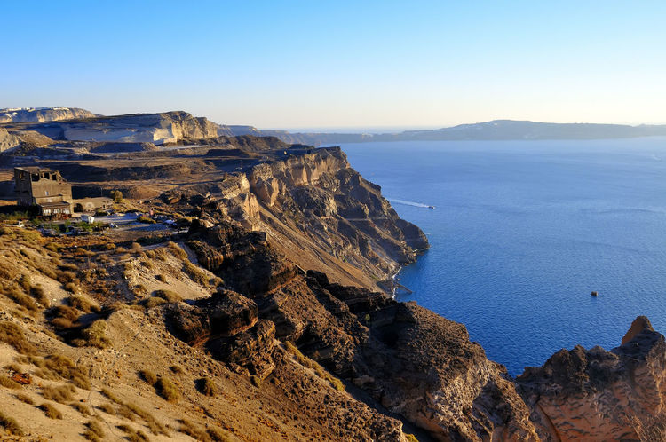 santorini grecia Grecia Santorini, Greece Arid Climate Beauty In Nature Blue Clear Sky Cliff Day High Angle View Landscape Mountain Mountain Range Nature No People Outdoors Physical Geography Rock - Object Rock Formation Scenics Sea Sky Tranquil Scene Tranquility Travel Destinations Turismo Isla Water