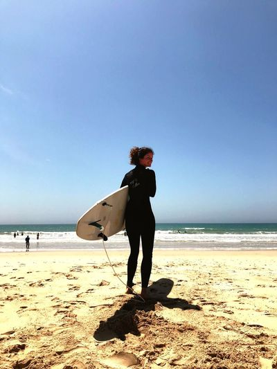 J-Bay Jbay Waves Wetsuit Low Angle View Longboard Surfboard Surf Surfing EyeEm Selects Beach Sea Real People One Person Full Length Horizon Over Water Lifestyles Leisure Activity Sand Clear Sky Standing Nature Day Outdoors Young Adult Sky Holding Water Blue Young Women