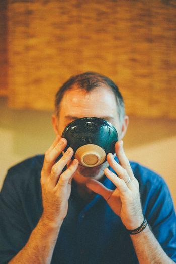 Portrait of a man drinking coffee