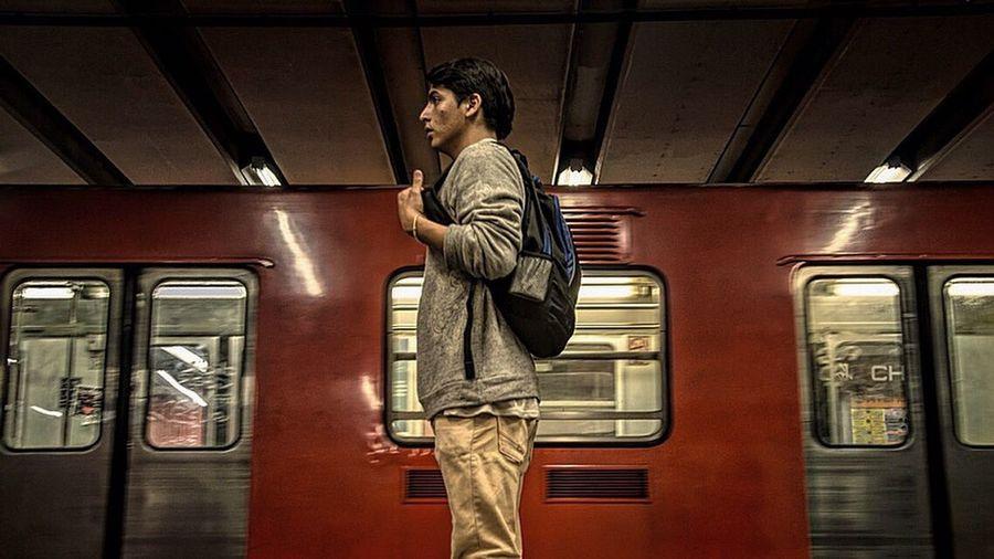 Man standing at railroad station