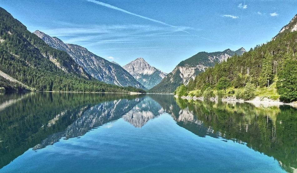 Mountain Reflection Beauty In Nature Sky Landscape Outdoors Lake Scenics Mountain Range Nature Vacations Symmetry Water Day Travel Destinations Snow No People Tree Plansee Austria First Eyeem Photo Hiking❤