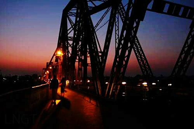 Long biên Night Bridge - Man Made Structure Built Structure Dusk Travel Destinations City Sunset Architecture Sky Illuminated Outdoors No People Water Cityscape