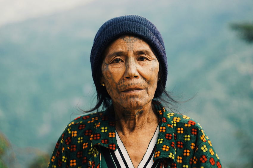 Woman with traditional tattoos in Mindat, Myanmar. Headshot Front View Tattoo Life