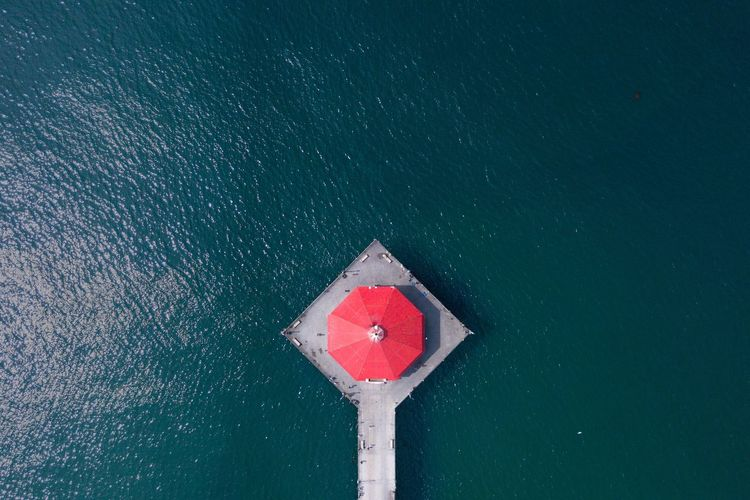 Aerial view of red gazebo at beach