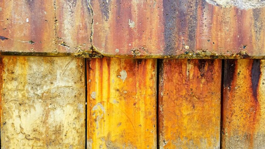 Breakwall Backgrounds Close-up Textured  Pattern No People Outdoors Architecture Lifestyles Copy Space Multi Colored Bold Dramatic Wall Sections Lines Vertical Gold Yellow Weathered Full Frame