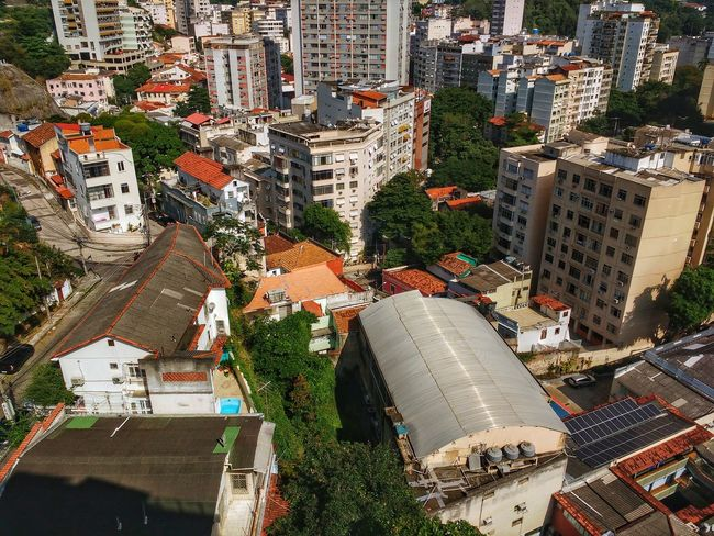 High-angle view of houses, buildings, and high-rise flats surrounded by lush green forested areas. No People Day Outdoors Backgrounds Nature Scenics Tropical South America Latin America Metropolis Brazilian Urban Jungle Cityscape Nature Tourism Travel Destinations Forest High Angle View Aereal View Capital Cities  Nature Meets Urban Ecology Architecture Building Exterior Built Structure