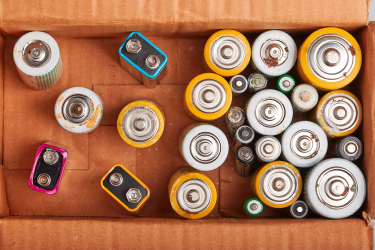 Directly above shot of batteries in cardboard box