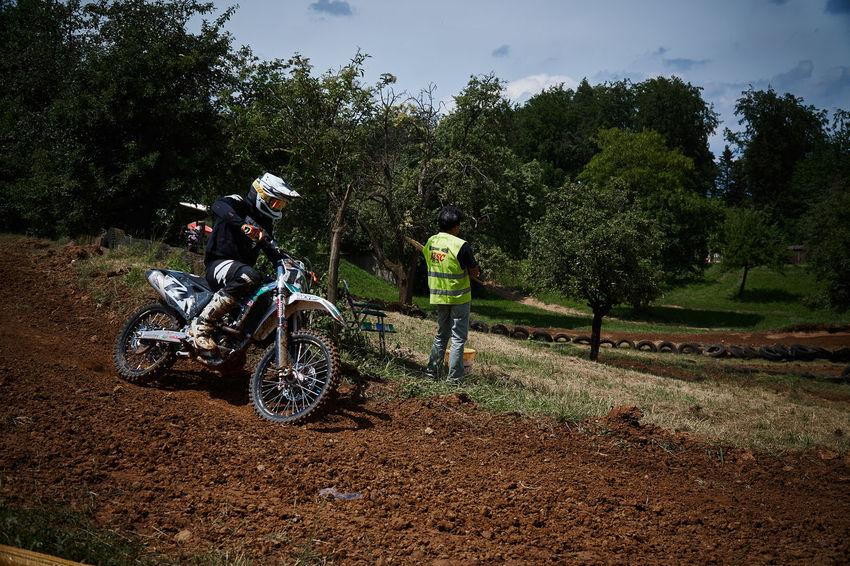 Motocross Driving by Crash Helmet Dirt Extreme Sports Helmet Land Land Vehicle Men Mode Of Transportation Motocross Motorcycle Nature People Plant Real People Ride Riding Transportation Tree