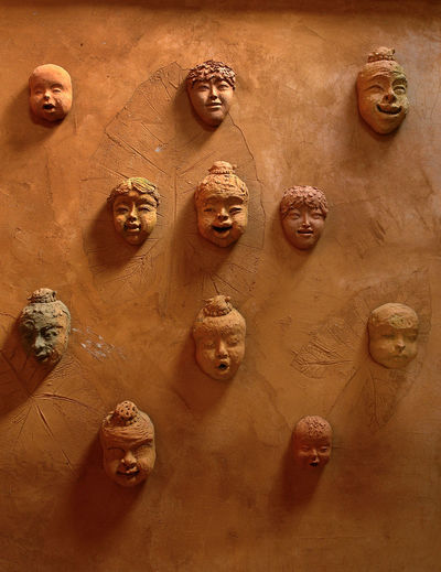 Close-up Day Full Frame Human Representation Indoors  Light And Shadow No People Restaurant Decor Sculpture Of Many Faces Wall - Building Feature
