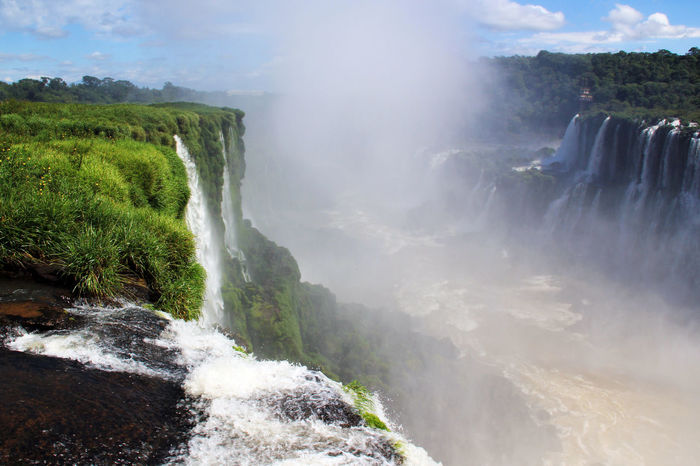 Iguazu Falls in Argentina and Brazil Brazil Iguazu National Park Argentina Beauty In Nature Cliff Day Flowing Water Force Iguazu Falls Motion Nature No People Outdoors Power In Nature Rapid River Running Water Scenics Sky Speed Splashing Tranquil Scene Water Waterfall