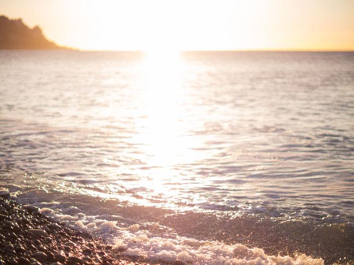 Beach Beauty In Nature Calm Horizon Over Water Idyllic Non-urban Scene Scenics Sea Shore Sun Sunset Tranquil Scene Tranquility Water