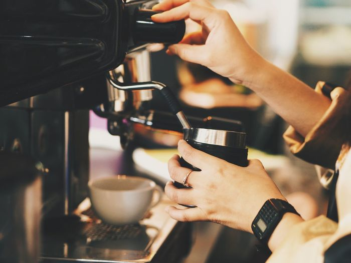 Close up barista hands with coffee machine. Barista Cafe Cappuccino Close-up Coffee - Drink Coffee Cup Cup Day Drink Espresso Espresso Maker Food And Drink Freshness Holding Human Body Part Human Hand Indoors  Machinery Making One Person Pouring Preparation  Real People Refreshment Working