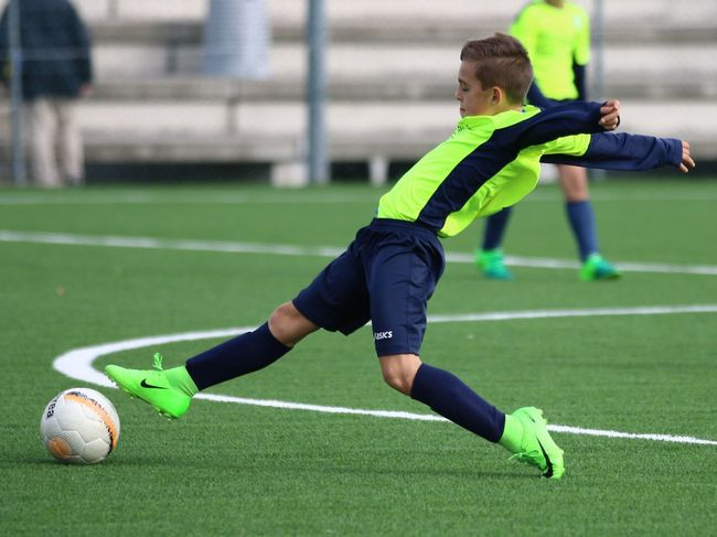 Green Color Soccer Soccer Player Sport Soccer Field Activity Grass Sportsman Soccer Ball Athlete Atterraggio Sports Clothing Adult Motion Kicking Focus On Foreground Soccer Uniform Concentration Sports Uniform People Two People