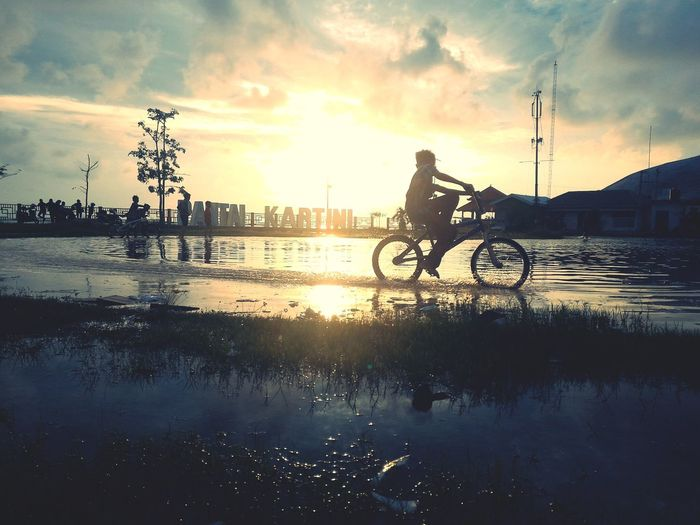 Bike | Water Only Men Reflection Silhouette Cloud - Sky Sunset Sky Adult People Adults Only Outdoors Men Full Length Young Adult Sport Day Lake Real People Nature Tree EyeEmNewHere Horizon Over Water Tranquility Mobilephotography Let's Go. Together. Sommergefühle EyeEm Selects