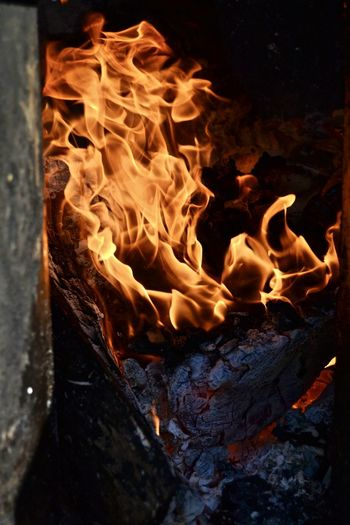 High angle view of fire on wood at night