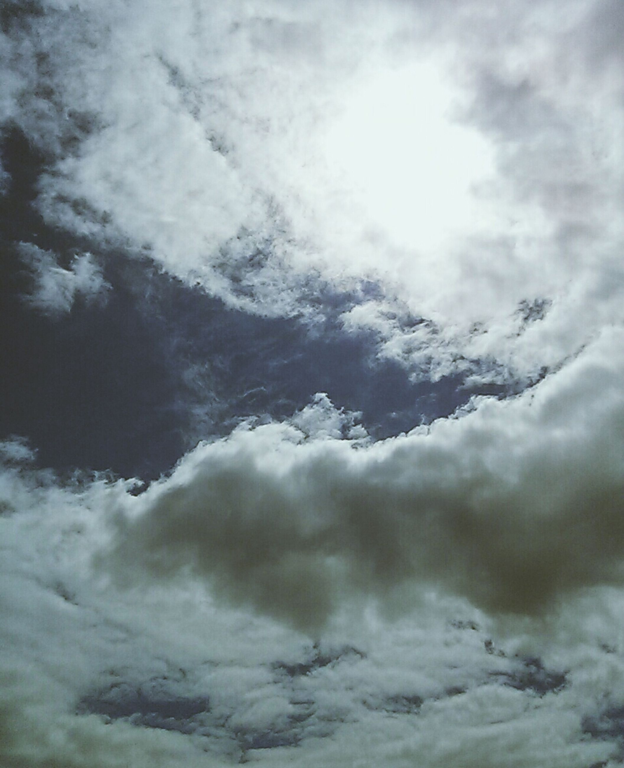 cloud - sky, sky, cloudy, weather, beauty in nature, low angle view, cloudscape, tranquility, scenics, sky only, nature, tranquil scene, overcast, cloud, backgrounds, full frame, idyllic, white color, day, outdoors